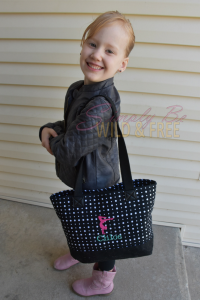 Thirt-One Demi Day Bag carried by sweet girl