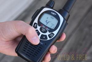 Child holding a walkie talkie two way radio