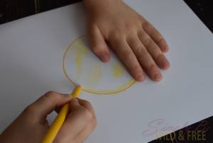 Coloring in your traced circle before you get out the finger paints for this fun summer craft