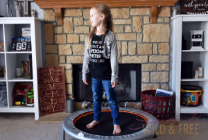 Jumping on a mini exercise trampoline is a great workout for homeschoolers too