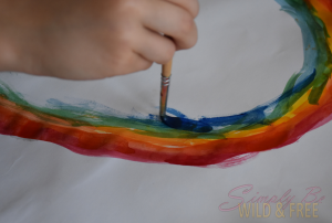 Use watercolors to paint the rainbow this summer